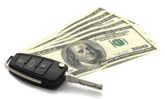 Car Key and Dollars isolated on white.